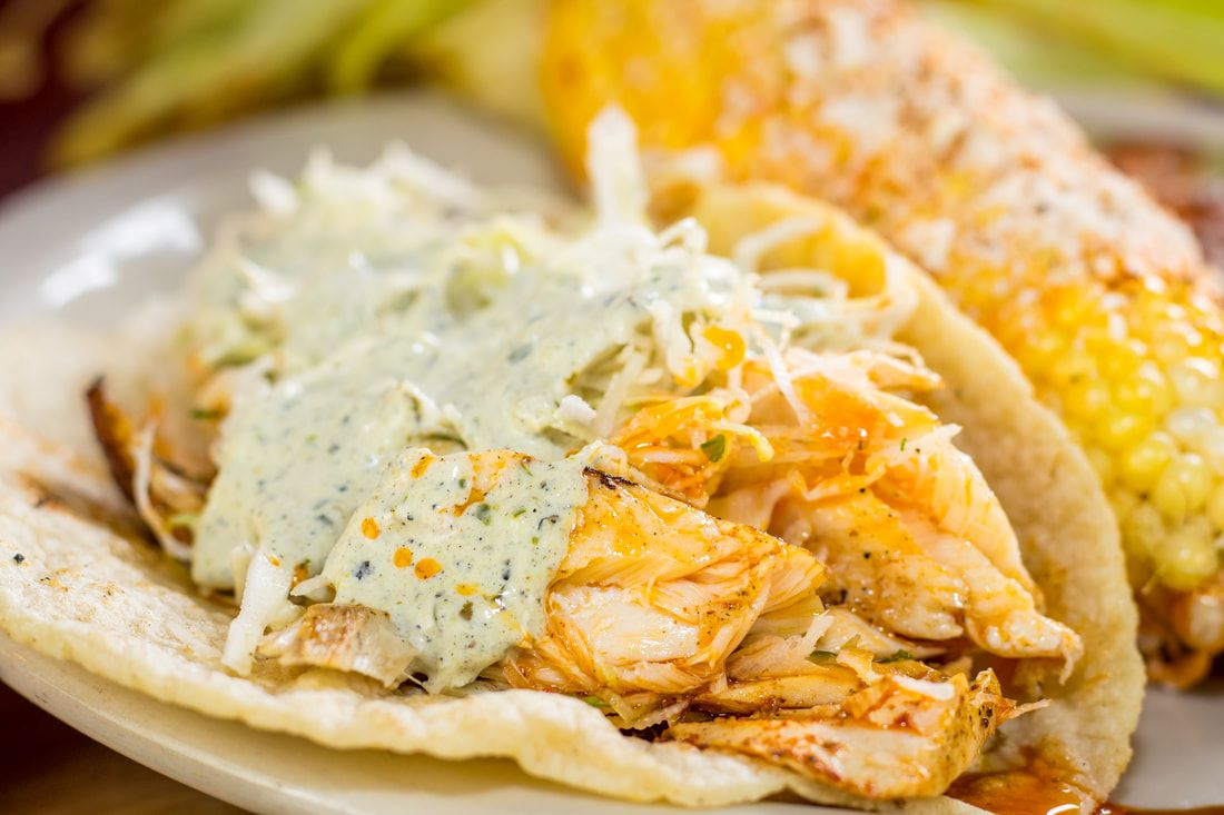 Best fish tacos in San Antonio, TX - Beto's fish tacos are made with grilled Alaskan pollock topped with fresh cilantro lime slaw and poblano sauce